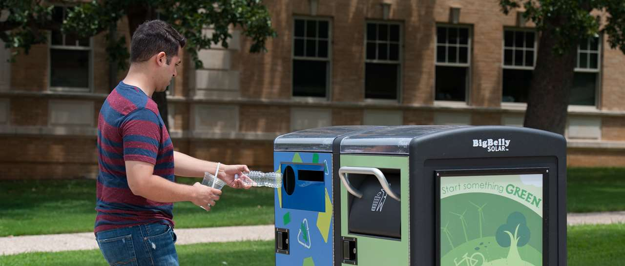 Big Belly Solar compacting trash cans are being installed around the UNT Denton campus that will include two sections – a trash can section and recycling section. The cans will send information to UNT Facilities on how much trash UNT generates, as well as how much recycling material is generated. Compacting cans will mean fewer trips to empty the trashcans for UNT facilities employees as well. The cans are being installed as part of an overall reorganization of recycling efforts and programs at UNT. Photos taken on July 28, 2014. (Ahna Hubnik / UNT)